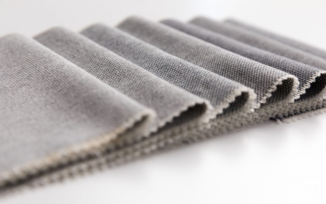 How do you recognize different fabric compositions in your textile product?